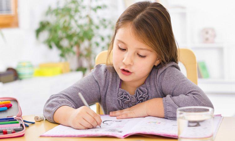Little kid at home doing homework; Shutterstock ID 262543760; Purchase Order: -